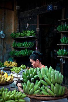 A banana seller waits for customers, Khanh Hoa Province, VIetnam, Southeast Asia