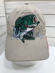 2ca1eb2db7d Bass Pro Shops Embroidered Fish Logo Baseball Cap Hat Fishing Strap Back  Tan  BassProShops