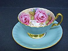 Gorgeous Aynsley, fine English bone china Teacup and Saucer, It comes with Gold pedestal and handle and most beautiful roses - decorations on inside the cup, It truly is precious.
