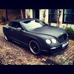 Matte black Bentley. That looks like leather