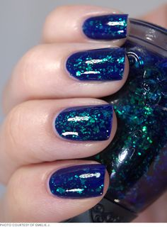I love this blue/green shade. 7 Dazzling Holiday Manicure Ideas
