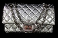 AUTH CHANEL Silver Quilted Leather 226 Reissue Double Flap Chain Strap Handbag at www.ShopLindasStuff.com