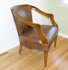 Mid Century Vintage Leather Chair. Polished wood frame and brown leather upholstery. $295 Chicago