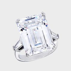 20.0 carat classic emerald-cut center with a single tapered baguette on each side. An approximate 20.70 total carat weight.
