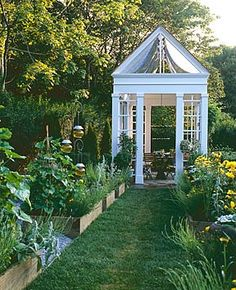 cute conservatory. Like the raised beds