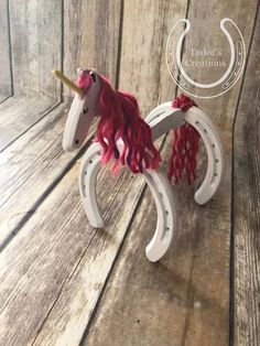 Omergherd Horseshoe Unicorns!!!!!  We can paint these in any color as a solid or mixed color. We also can do the mane and tail in different colors but those options arent available on the listing so please shoot us a message on what color you would like!!! If you dont see a color