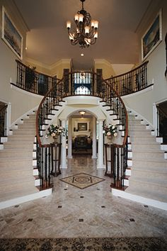 Toll Brothers Two-story foyer with curved staircases. Gorgeous! Reminds me of our Biloxi Mississippi Home. Wonderful Memories!