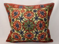 This item is fully hand embroidered with shiny silky threads cushion cover. A gorgeous decoration for your home interior !    Measurement: 16x16 and