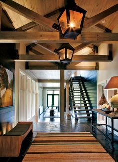 such a fantastic mix of textures...wood ceiling, tile floors but still lots of white