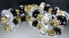 Sahara Night-a beautiful bracelet with gold Trollbeads and the new Sahara Night Facet bead. http://www.trollbeadsgallery.com/sahara-night-facet/