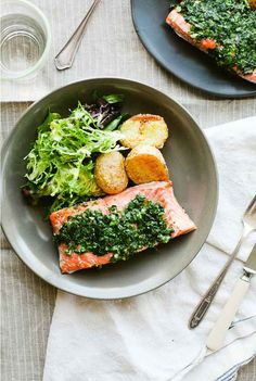 Salmon, crispy potatoes and greens