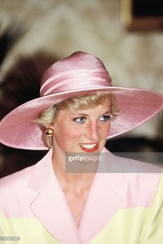Diana, Princess of Wales, on a visit to the Yaounde Deaf and Dumb School during her official visit to Cameroon on March 21, 1990 in Yaounde, Cameroon. The princess wears a Catherine Walker suit with a hat by Philip Somerville.