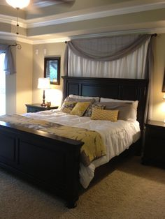 Minus the curtains. White grey yellow master bedroom. Absolutely LOVE the black furniture!