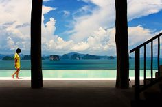 The iconic view of Phang Nga Bay's limestone rocks from The Hilltop Reserve restaurant at Six Senses Yao Noi, Thailand.