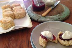 simple gluten-free scones   Jamie Oliver   Makes 8 1 cup gluten-free plain flour¼ cup white rice flour 2 teaspoons baking powder ¼ cup almond meal a good pinch of sea salt 60ml cream 125ml milk, plus a little extra for brushing strawberry jam, to serve whipped cream, to serve http://www.jamieoliver.com/newsandblogs/blogs/simple-gluten-free-scones/