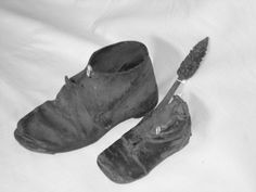 Shoes in the Wall--article--many date to 1700's, 1800's, but even as far back as the 1400's. Folklore suggests built into walls to ward off evil