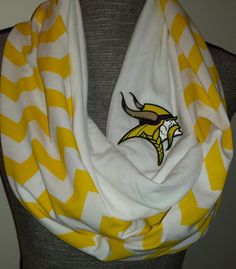 "Minnesota Vikings Infinity Scarf with Embroidered Logo. Hoop length is about 38"" inches long by about 8"" inches wide. Wraps around twice comfortably. Light weight / indoor or outdoor scarf. Scarf is f"