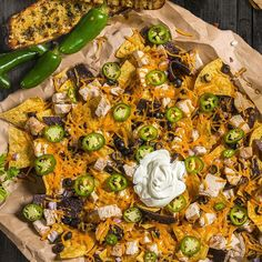 Nothing says fiesta like nachos, pile them higher with barbecued chicken for nachos grande, they're mucho delicioso.