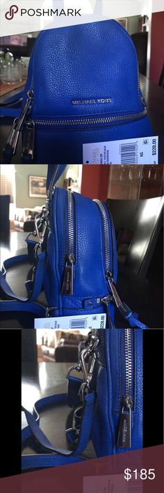 Adorable Michael Kors Electric Blue mini Backpack Slightly used mini backpack . Adjustable straps , two compartments . Cute for everyday use . Retails for $228. Michael Kors Bags Backpacks