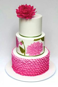 Pink and green cake with rolled petals and flowers