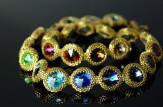 Pattern: My own - 20 colours of gorgeous Swarovski 14mm rivoli's framed in 24K gold plated delica's and size 15 seed beads