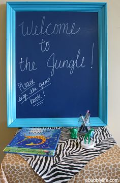 Have guests sign a children's book at the baby shower. Jungle theme