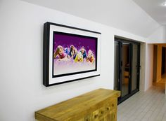 We produce TV artwork so you no longer have to choose between TV & art. Our moving artwork creates a beautiful centrepiece in any room when the TV is off. White Tv, Black And White, Living Area, Living Room, Framed Tv, Atrium, Picture Frames, Centerpieces, Artwork
