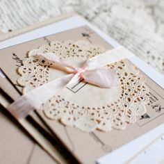 Love this idea too for invitations - but replace light pink ribbon with light blue or seersucker ribbon