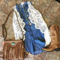 Crocheted vest, denim tunic, fringe crossbody purse and Ashlee Lace boots by Lane. This outfit is the ideal outfit for a Cheyenne Frontier Days concert:)