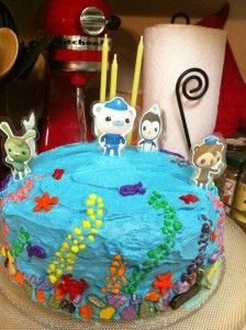 Octonauts Cake--used Nerds for the coral reef, candy rocks from World Market for the bottom row.  Laminated characters on cardstock are on the top)--use tweezers to apply the Nerds