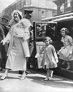 1935: Lady Elizabeth, the Duchess of York, is followed by her daughters, the 9-year-old Princess Elizabeth, right, the future Queen Elizabeth II, and 5-year-old Princess Margaret, arriving at London's Olympia for the Royal Tournament.