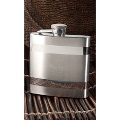 "Two-Tone Flask  This two-tone, stainless steel flask measures 4 1/2"" tall and holds up to 6 ounces. Personalization options include; engraved name or monogram. Shown with option 1 in lettering style C2L.    Format option include:  1. Name  2. Single Initial  3. Three Initials - all the same size  4. Classic Monogram - center initial larger  Two-Tone Flask (Personalized)  Please specify personalization.  $39.90 each"