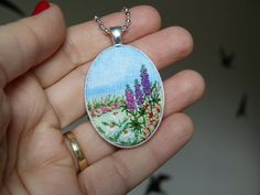 Embroidery necklace Landscape pendant Embroidered lupine Herbs Silver tone Needlework Floral meadow Hand-painted Hand embroidered. This pendant is hand embroidered and hand-painted. Ready for shipment. Pendant size: 50x32mm / 1,97x1,26 Chain Length: 65 cm / 25,59 (default, I