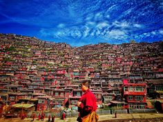 This photographer was travelling to Sertar County in China when he visited the local Buddhist Insititute and snapped this picture of a monk walking by.