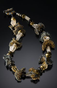 Petals Necklace: Julie Powell: Beaded Necklace Czech and Japanese glass beads into intricate petals, then combines them with golden rutilated quartz, smokey quartz, and African brass beads.