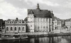 Bank of the Pregel river in Koenigsberg, with a little public transportation steamer at bottom left. Jeff