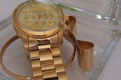 Michael Kors golden watch & bow bracelet