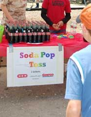 "Carnival Game Ideas ~ Soda Pop Toss: Set up large grouping of individual glass sodas  2 - 4 dozen or so - in the middle of the carnival booth or on a table.  Carnival players are given five rings to try their hand ""ringing"" one of the individual glass soda bottles. ""Ring"" a soda and win a prize, plus, keep the soda :)"