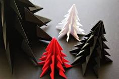 Handmade Holiday: 14 DIY Origami Ornaments — From the Archives: Greatest Hits Origami Christmas Ornament, Origami Ornaments, Christmas Tree Garland, Mini Christmas Tree, Xmas Trees, Christmas Paper, Rustic Christmas, Snowflake Origami, Diy Ornaments