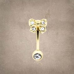 """Cute gold bow with clear crystals rook earring, gold daith piercing, gold eyebrow ring. The barbell is 16 gauge and 14kt gold plated surgical steel that is 5/16"""" (8mm) long. Will arrive in a gift box."""