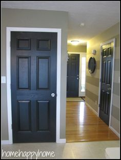 UPGRADE your home interior with Black Doors... also love the striped paint on the wall