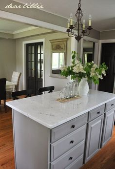 Cabinet color is Galveston Gray from Benjamin Moore. Awesome kitchen revamp from Dear Lillie