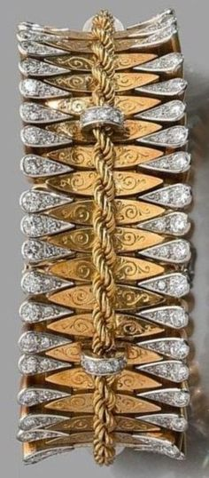An Art Deco platinum, gold and diamond bracelet, circa 1935. A bracelet of a very simular design by Van Cleef & Arpels was sold at Pierre Bergé & Associés in Brussels, June 2007. #ArtDeco #bracelet