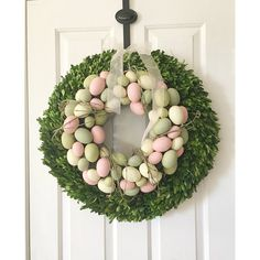 Wow! Isn't this a creative idea for Spring Decor? Combine two awesome wreaths to create one unique arrangement. Love it! Yes, that's an Antique Farmhouse boxwood wreath. Thanks for sharing Lacey. #decoratingideas