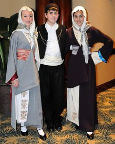Members of the St. George Greek Folk Dancers of New Port Richey waiting to perform at the 2010 Hellenic Dance and Choral Festival in Orlando, Florida, January 16, 2010. The dancers are wearing costumes representing traditional dress from the Greek island of Kalymnos, or Κάλυμνος, which is in the southeastern Aegean Sea. The costumes were borrowed from a Tarpon Springs dance group and feature a variety of rich fabrics along with traditional cross-stitched motifs. The decorative bird showing…
