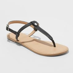 364ae3001483 These Odette Thong Sandals from Cat and Jack will breathe freshness into  your girl s warm-weather footwear collection. The flat open-toe sandals are  made ...