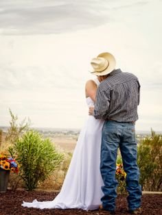 I love that she's in her dress, and he's in his jeans and cowboy hat (: