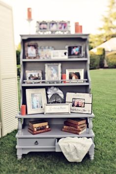 Use an old shelf and display pics.  Really cool looking!