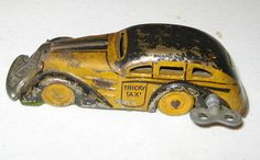 1930s taxi yellow cab tin toy