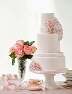 """Pink cake with flowers!  We can help achieve this look at Dallas Foam with cake dummies, cupcake stands and cakeboards. Just use """"2015pinterest"""" as the item code and receive 10% off your first order @ www.dallas-foam.com. Like us on Facebook for more discount offers!"""